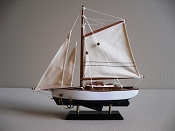 Small Sail Boat, Blue Bottom With White Sides.  L-9.5in  W-2in  H-9.75in