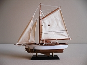 Small Sail Boat, Brown Bottom with White Sides  L-9.5in  W-2in  H-9.75in