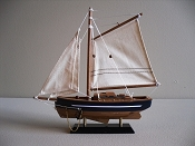 Small Sail Boat, Light Brown Bottom With Blue Sides & White Stripe, L-9.5in  W-2in  H-9.75in