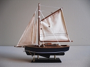 Small Sail Boat,  Black Bottom with Blue Sides & White Stripe.  L-9.5in  W-2in  H-9.75in