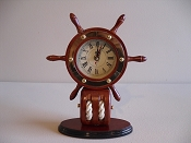 Small Ship Wheel Clock (Battery Operated) L-9in  W-3 1/2in  H-10 1/2in