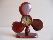 Wood Propeller Clock  (Battery Operated) L-12in  W-4 1/2in  H-12in