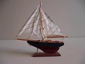 Small Souvenir New Look Sail Boat, Dark Blue W/ Dark Red Bottom,  L-9.5in  W-1.75in  H-9.25in