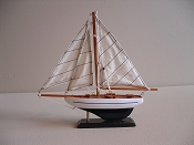 Small Souvenir New Look Sail Boat, White W/ Blue Stripe W/ Dark Blue Bottom, L-9.5in  W-1.75in  H-9.25in