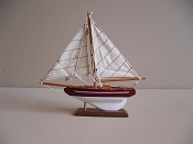 Small Souvenir New Look Sail Boat, Dark Red W/ White Stripe W/ White Bottom,  L-9.5in  W-1.75in  H-9.25in