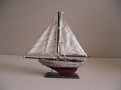 Small Souvenir Weathered Sail Boat W/ Red Bottom,  L-9.5in  W-1.75in  H-9.25in