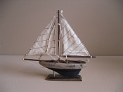 Small Souvenir Weathered Sail Boat W/ Dark Blue Bottom,  L-9.5in  W-1.75in  H-9.25in