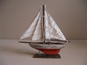 Small Souvenir Weathered Sail Boat W/ Orange Bottom,  L-9.5in  W-1.75in  H-9.25in