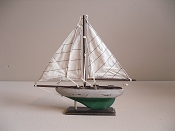 Small Souvenir Weathered Sail Boat W/ Green Bottom,  L-9.5in  W-1.75in  H-9.25in