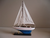 Medium New Look Souvenir Sail Boat White W/ Red Stripe Light Blue Bottom, L-10.25in  W-2.5in  H-14in