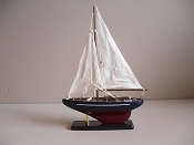 Medium New Look Souvenir Sail Boat Dark Blue W/ White Stripe Dark Red Bottom,  L-10.25in  W-2.5in  H-14in