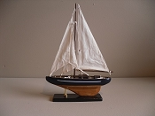 Medium New Look Souvenir Sail Boat Dark Blue W/ White Stripe Wood Grain Bottom,  L-10.25in  W-2.5in  H-14in