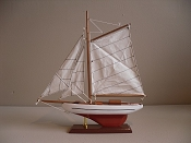 Large Souvenir Sail Boat White W/ Black Stripe W/Dark Orange Bottom, L-12.5in  W-2.5 in  H-14in