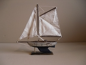 Small Souvenir Weathered Sail Boat W/ Dark Blue Bottom, L-9.75in  W-2in  H-10.5in