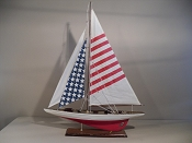 Medium Collectible Sail Boat W/ American Flag Sails, Off White With Red Bottom, L-26 in  x W-4 1/2 in  x H-33 1/2 in