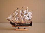 Medium Souvenir Ship W/ Black & White W/Wood Look Bottom   9'L x 2'W x 9'H