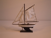 Small Souvenir Weathered Sail Boat W/White, W/Black Bottom  L-10in  W-2in  H-10.5in