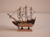 Small Souvenir Pirate Ship, Black Pattern W/ Wood Brown Bottom. L-6.25in  W-1.5in  H-6.25in