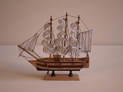 Medium Souvenir Ship W/White Sails & Black Stripes, Wood Brown W/Dark Brown Stripes &  Dark Brown  Bottom.  L-9.5in  W-2.25in  H-9.5in