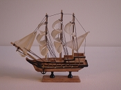 Medium Souvenir Ship W/White Sails, Light Wood W/Black Stripes & Gold Cannons, L-9.5in   W-2.25in   H-9.5in