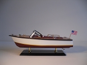 Medium Collectible Speed Boat, White W/Gold Stripe, Brown Bottom.  L-14in  W-5in  H-5.5in