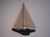 Small Weathered Half Hall Sail Boat, Tan Sails, Black W/White Stripe, Weathered Black Bottom.  L-9.5in  W-1.25in  H-13in