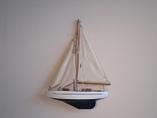 Small Half Hall Sail Boat, Tan Sails, White W/Black Stripe, Dark Blue Bottom.  L-9.5in  W-1.25in  H-13in