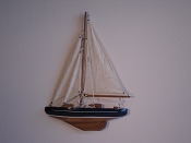 Small Half Hall Sail Boat, Tan Sails, Blue W/White Stripes, Wood Bottom.  L-9.5in  W-1.25in  H-13in