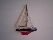 Small Half Hall Sail Boat, Tan Sails, Blue W/White Stripes, Red Bottom.  L-9.5in  W-1.25in  H-13in