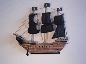 Small Half Hall Pirate Ship, Black Sails, Wood Brown, Black Bottom.  L-8.5in  W-1.25in  H-7.75in