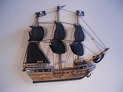 Medium Half Hall Pirate Ship, Black Sails, Wood Brown, Black Bottom.  L-12.25in  W-1.5in  H-10.25in