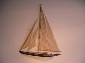 Large Weathered Half Hall Sail Boat, Tan Sails, Weathered Black W/White Stripe, Weathered White Bottom.  L-24in  W-2.25in  H-31.5in