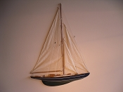 Large Half Hall Sail Boat, Tan Sails, Dark Blue W/White Stripes, Green Bottom.  L-24in  W-2.25in  H-31.5in