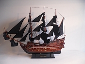 Extra Large Collectible Pirate Ship, Dark Red Wood W/White & Black Stripes, Black Bottom. Gold Cannons & Decorative Wood Engravings.  L-40in  W-8in  H-33.5in